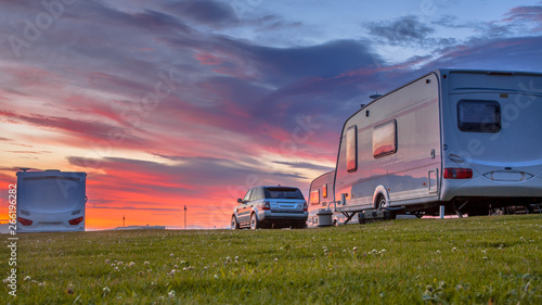 Camping caravans and cars  sunset Fotobehang