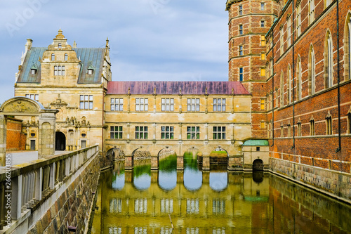 Photo  Frederiksborg castle or palace: Castle walls and moat with water and bridge