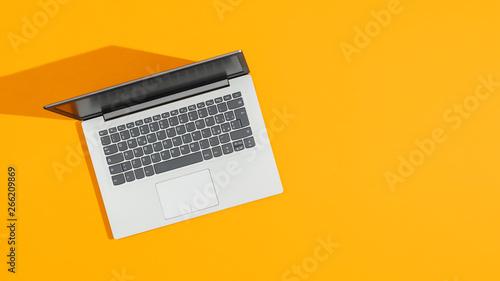 Fotografia  Laptop on a bright yellow desk