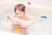 Happy 5 Year Old Playing In A Bathtub