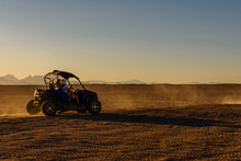 Unrecognizable People Driving Buggy During Safari Trip At Sunset In Arabian Desert Not Far From The Hurghada City, Egypt