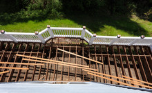 Top View Of An Aged Outdoor Wooden Cedar Deck Being Tore Down Due To Weathered Boards