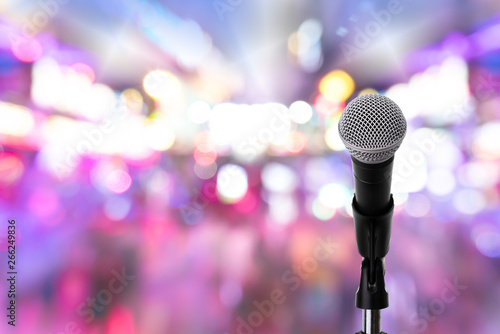 Microphone on stage ..Close up of dynamic microphone setting on stand with colorful light bokeh background ,celebration event . #266249836