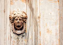 Exterior Vintage Door Knocker Metal Circle On A Wooden Door Of An Ancient Building In Catania, Sicily, Italy.