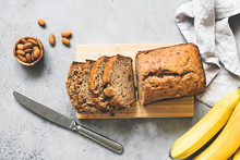 Gluten Free Paleo Banana Bread On Grey Concrete Background, Table Top View