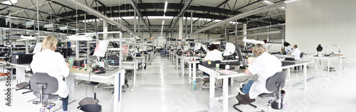 Fotografiet  workers in a factory for the production of electronics - modern industrial enter