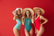 canvas print picture - Beautiful young women in swimsuits on color background