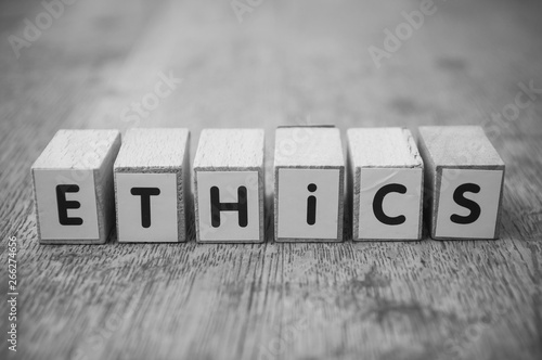Closeup of word on wooden cube on wooden desk background concept - Ethics