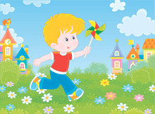 Little Boy Running And Playing With His Toy Whirligig Among Flowers On Green Grass Against A Background Of Colorful Houses Of A Small Town On A Sunny Summer Day, Vector Illustration In A Cartoon Style