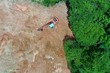 Leinwandbild Motiv Deforestation. Logging and forestry. Rainforest jungle in Southeast Asia destroyed to make way for palm oil plantations