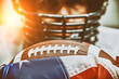 Leinwandbild Motiv American football concept. The ball for the American football lies on the flag of America against the background of the portrait of the American football player.