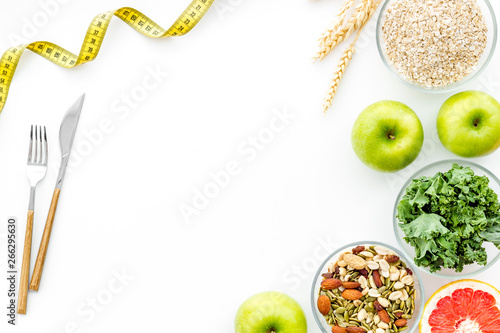 Weight loss concept with green organic food on white background top view space for text - 266295630