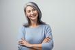 Leinwandbild Motiv Smiling Asian senior woman with crossed arms