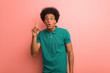 canvas print picture - Young african american man over a pink wall having a great idea, concept of creativity