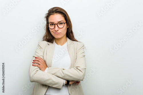 Young european business woman frowning her face in displeasure, keeps arms folded Wallpaper Mural