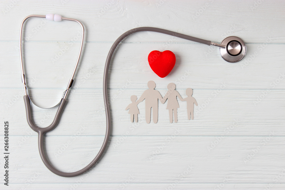 Fototapeta stethoscope and heart on a colored background top view. Family medicine