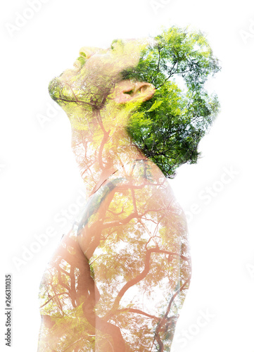 Obraz Double exposure of a young bare-chested man's portrait blended with bright green leaves, showing the perfect beauty of nature's creation - fototapety do salonu