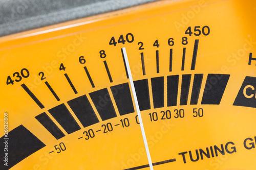 Vászonkép Macro close up detail of calibration meter on old guitar tuner.