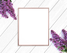 Rose Gold Frame Mockup On A Wooden Painted White Background. 4x5 Portrait.