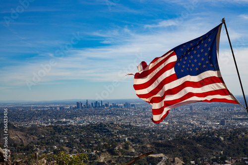 USA Flag Waves over City of Los Angeles California Fototapet
