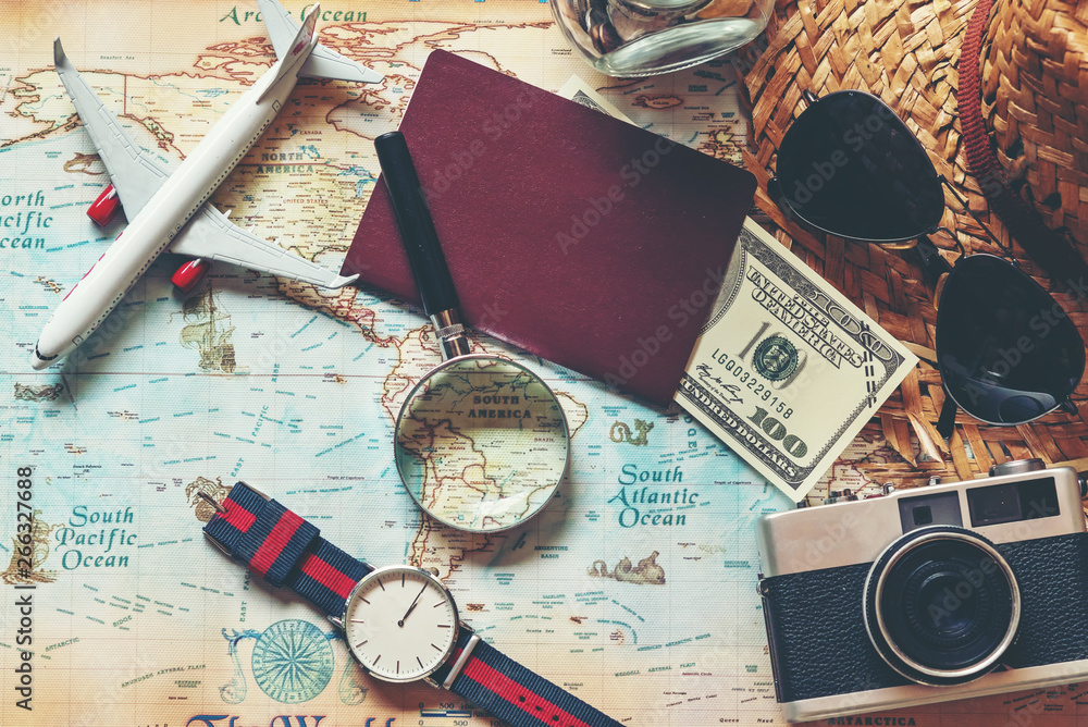 Fototapeta .Top view of Traveler accessories and items man with black for planning travel vacations on the world, copy space.  Travel and Summer holiday concept