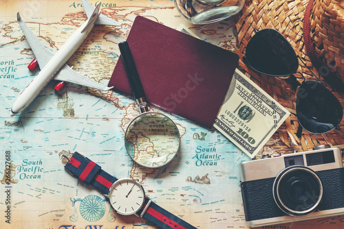 Fototapeta .Top view of Traveler accessories and items man with black for planning travel vacations on the world, copy space.  Travel and Summer holiday concept obraz