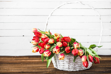 Spring tulip bouquet, basket with flowers. Background for women's day or mother's day card concept.