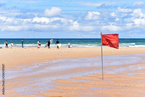 Red flag at Playa de Somo Beach in Santander, Cantabria, North Spain