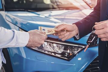 Dealer receiving money from client close up