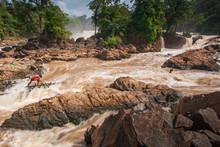 Laotian Fisherman Fishing In Rapids Of Khone Phapheng Falls.