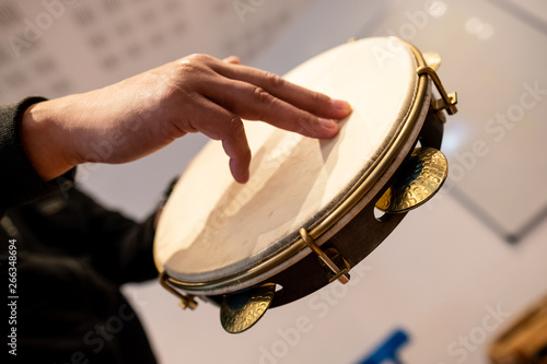 Hand playing a drum percussion music instrument musical rhythm drummer bass rock brasil beat patter chatter tap pounding thump rattle kit hit dig band snare cylinder finger sound art creation  - 266348694