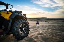 Summer Offroad Adventure On Atv In Sand Quarry. Entertainment Of Tourists In Desert In MUI Ne In Vietnam. Off-road ATV Wheel Close-up