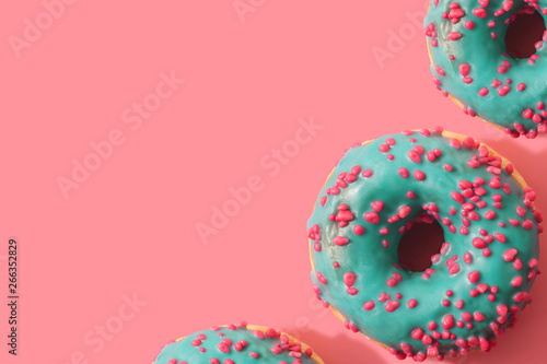 Fotografie, Tablou  Colorful background of donuts with copy space. Top view
