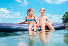 Sister And Brother, Have Fun When Swim On Inflatable Mattress In The Sea. Careless Childhood Time