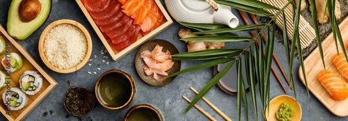 Spoed Foto op Canvas Kruidenierswinkel Overhead shot of ingredients for sushi on dark blue background