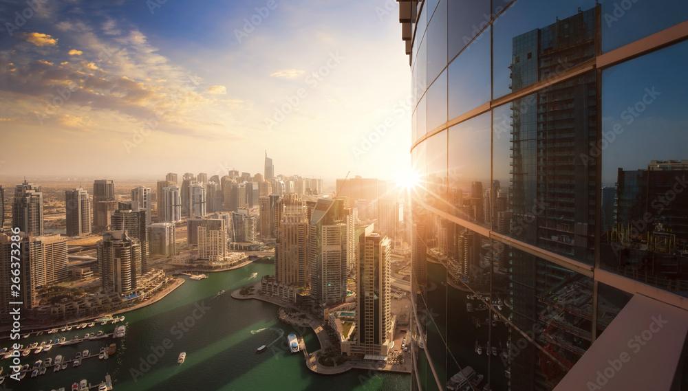 Fototapeta The skyline of Dubai Marina at sunset