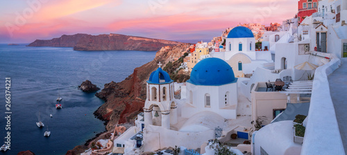 Foto auf Gartenposter Santorini The famous three blue domes in Santorini at sunset