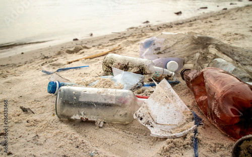 Fotografie, Obraz  The world environmental pollution problem and issue with Garbage beach: Spilled