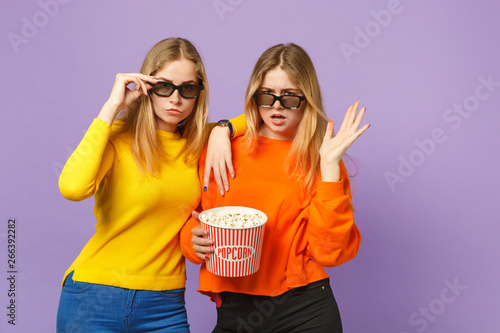 Two perplexed young blonde twins sisters girls in 3d imax glasse Wallpaper Mural