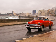 Driving The Rain. Malecon. Cuba