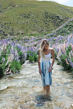 Woman Wading In A Stream Near ...