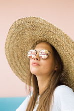 Girl Portrait In The Big Straw Hat In Cafe At Summer Holiday