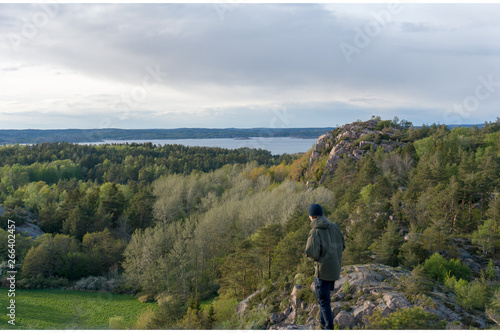 Active man hiking in the mountains viewing the landscape Canvas Print