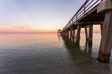 Calm Sunrise At The Pier