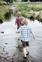 Two Boys Walking Upstream