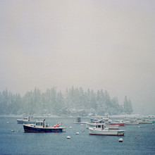 Fishing And Lobster Boats Float In The Harbor In Owls Head Maine.