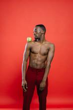 Shirtless Black Man With Apple