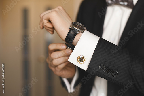 Valokuva Close view of the luxury watches on the hand of a handsome businessman in a tuxe
