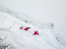 Aerial View Of Family In Winter Jackets Enjoying Hiking Together