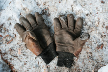 An Old Pair Of Worn Out Work Gloves.